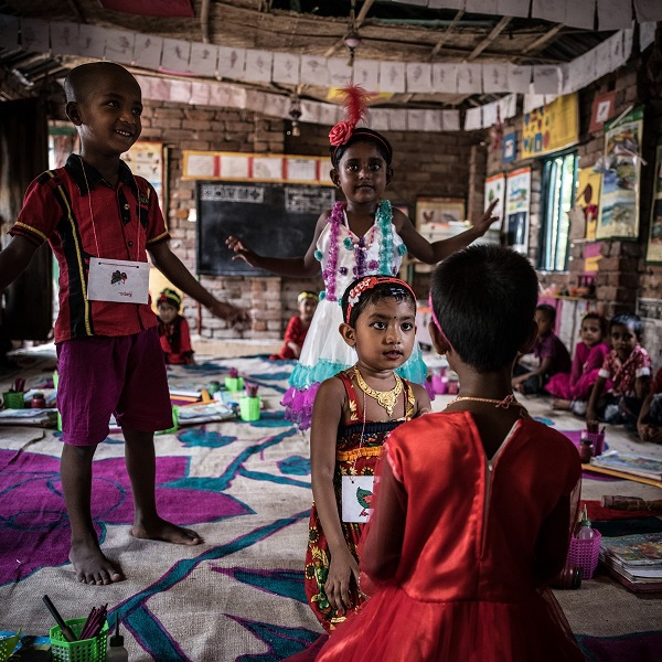 Children play an educational game in a UNICEF-funded preschool in Satkhira Sadar, Bangladesh.
