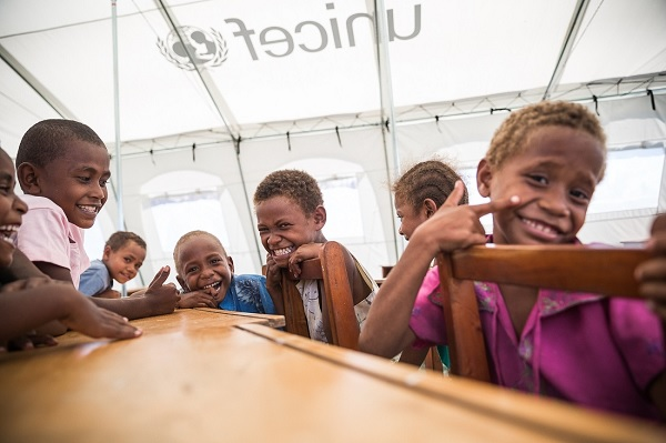 Students from Muslim Primary School in Dobuilevu village, Ra Province, can't wait to start school again. UNICEF gave to the school two school tents and teaching and learning materials.