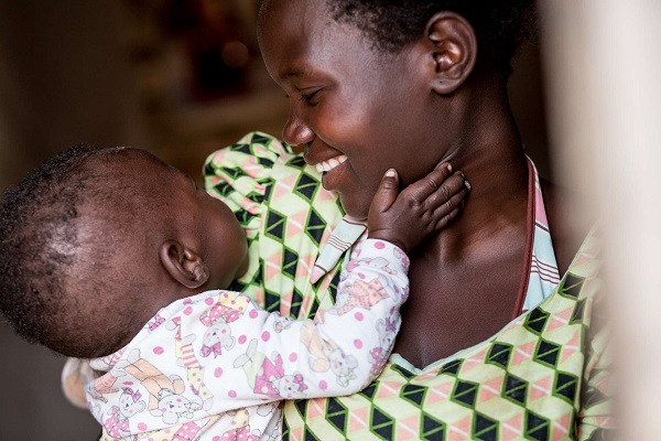 Martha Jere holds her 8 month-old son Rahim at their home in Bilemoni village, Malawi.