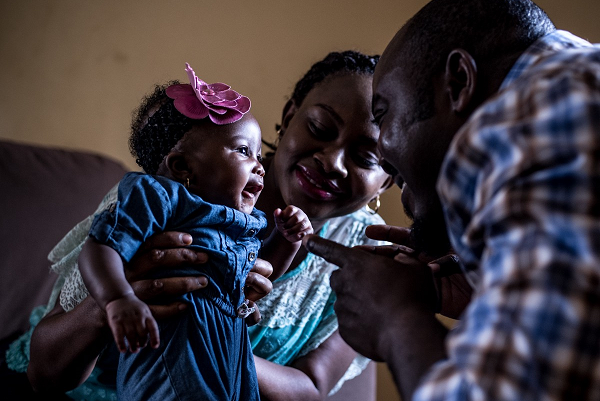 In Nigeria, Remi Falayi (centre), with her husband and daughter, 3-month-old Oluwatomini, has adjusted her work schedule so she can breastfeed her child.