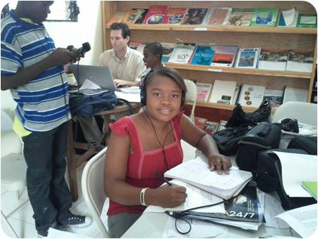 Youths in Haiti express themselves with the aid of UNICEF's radio training program.