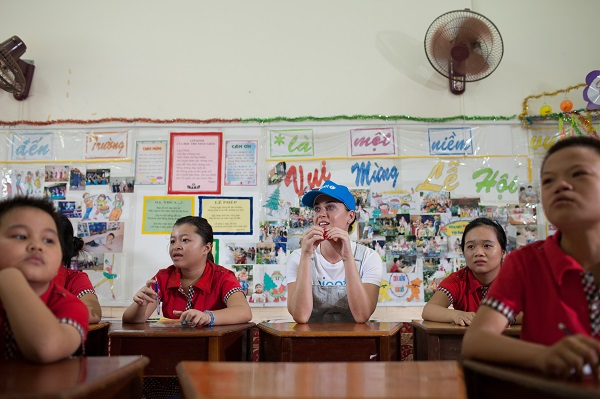 in Viet Nam, UNICEF Goodwill Ambassador Katy Perry (center) sits with students during a lesson at the Quang Son Daycare Center in Ninh Thuan Province.