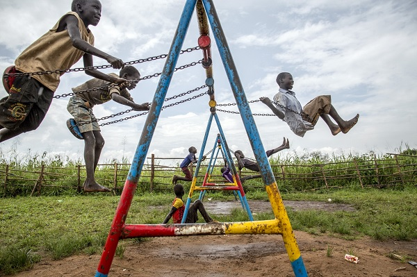 Children from South Sudan play at a child-friendly space in a refugee settlement in Uganda.