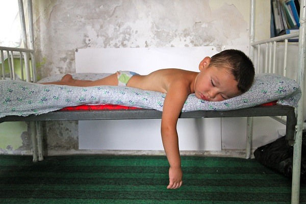 A boy naps at a UNICEF-supported school