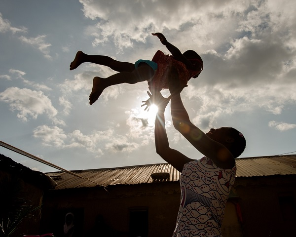 Munira plays with her baby daughter Lorentia, 2, at their home in Ghana.
