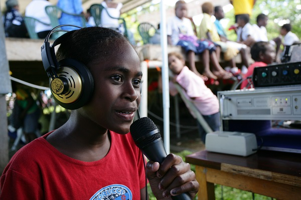 Children gain confidence expressing themselves with a UNICEF public access radio program.