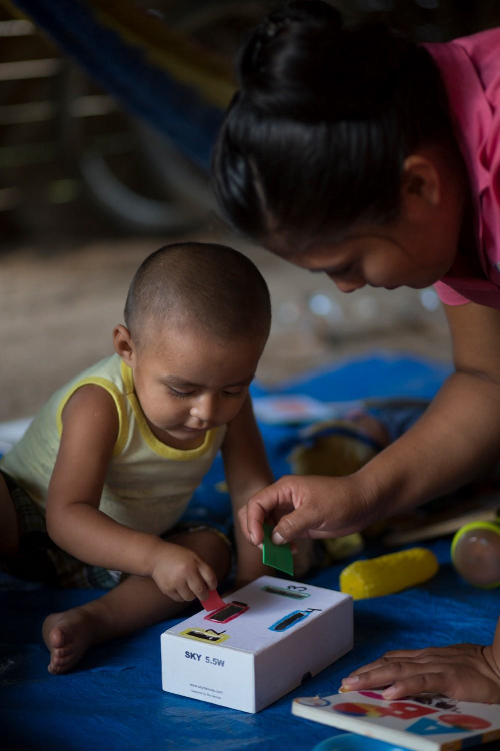 Abner, in San Felipe, enjoys playing with the various learning materials and toys.