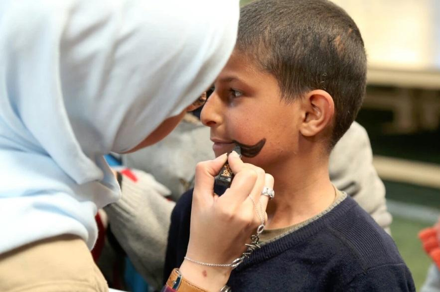 A child gets his face painted