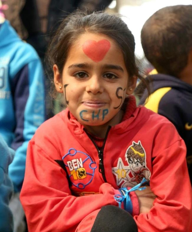A child has her face painted