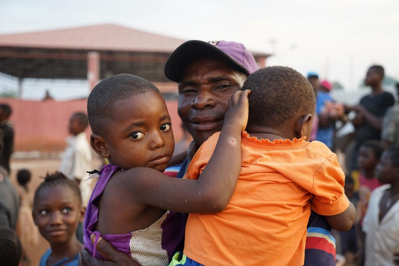 a father and his children in Angola