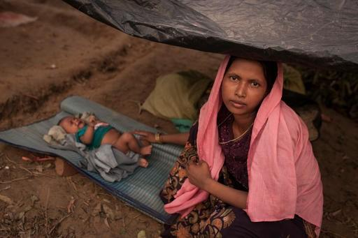 A Rohingya mother and baby take refuge at a camp in Bangladesh