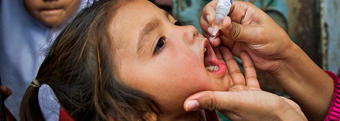 girl receiving polio vaccine