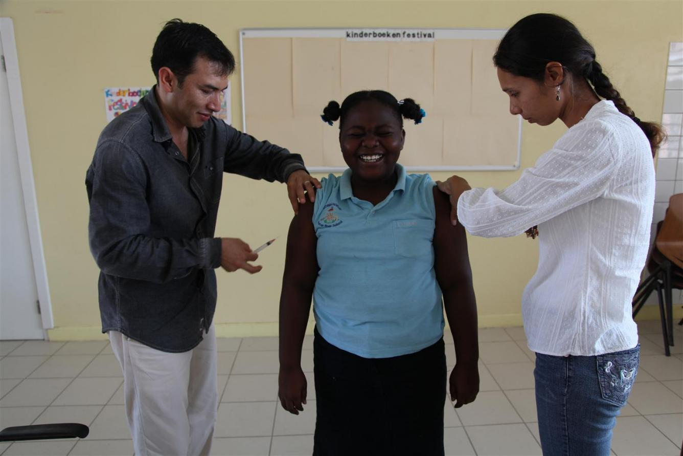 Girl being vaccinated Aruba